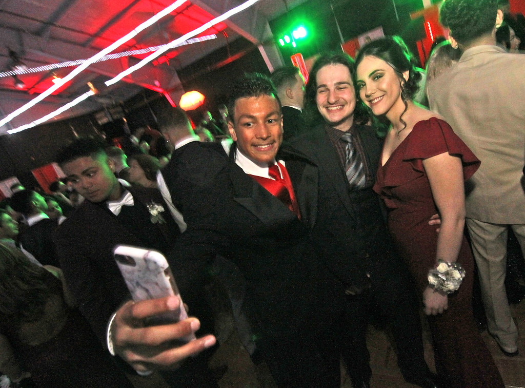 . Doing selfies at the Greater Lowell Tech Prom, L-R, Gabriel Pena 18, Al Mafra 17 and Analie Pizzo 18. SUN/David H. Brow