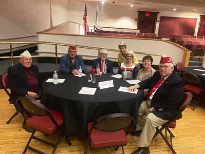 Veterans enjoy the speaking program.