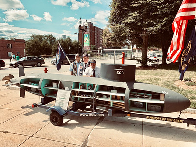 Standing behind the USS Thresher are veterans, from left, Frank Hood of Nashua, Tom Shannon of Dracut and George LeBlanc of Danvers.