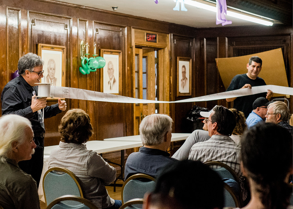 . Marc D\'Antonio, Chief Photo and Video Analyst for the Mutual UFO Network, uses a spool of paper to show the history of the universe as part of his discussion \'From Here to There: The Scientific Search for ET\' during the UFO Conference in Leominster on Saturday, October 7, 2017. SENTINEL & ENTERPRISE / Ashley Green