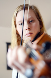 Young American Hannah Renno plays the violin in her Montandon home. Renno also plays the piano, the guitar, and the mandolin.