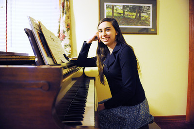 Young American Emily Spiegel, of Port Trevorton, poses at her piano.
