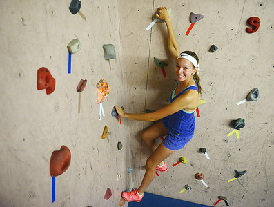 Young American Adrienne Yordy, a Meadowbrook Christian student, climbs a wall at the Milton Rock Gym.