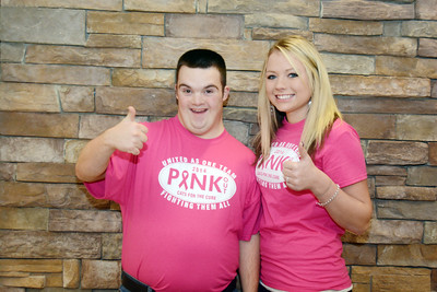 Mifflinburg students Randall Newswanger and Katelyn Sheesley give a thumbs up at the high school on Wednesday.