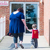 Jennifer Voegtle, of Milton, walk her 2-year-old son Brooks to the child care center at the Sunbury YMCA on Wednesday morning.