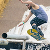 Phil Schoolden, of Baltimore, goes off the ramp during the Summer Snow Day at Gilson Boards in New Berlin.