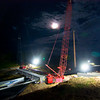 Work on the temporary bridge over Route 15 near Winfield continued on Wednesday night.