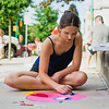 Saige Graham, 17 of Milton, works on piece from her sketch book during the the Lewisburg Chalk Art Festival on Friday.