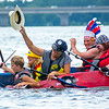 The Village People boat comprised of, Ben Kramer, Bethany Deppen, Heidi Kramer, Wally Kerstetter, and Morgan Kerstetter, laugh and celebrate as their boat sinks after the crossed the finish line during the Cardboard Boat Regatta in Sunbury on Saturday.