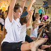 Gianna Feldmann, 11 of Danville, smiles while stretching on the ballet bar during Athen-Thon, a dance marathon to raise money for Athena Zellers.