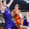 Robert Inglis/The Daily Item  Bucknell's Zach Thomas tries to drive the lane while guarded by Holy Cross's Matt Husek during Monday's game.