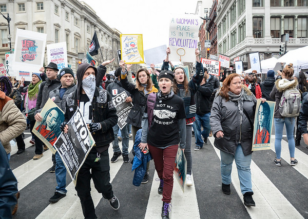 Robert Inglis/CNHI  Protesters march down 7th Street on Friday in Washington D.C. during the inauguration.