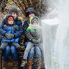 Jennifer Voneida and her son Luke, 5, left, sit with Amber Nadolny and her son, Danny 5, while watching Jared McAlister, of DiMartinos Ice carve an ice throne in Huffnagle Park in Lewisburg on Friday afternoon.
