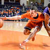 Robert Inglis/The Daily Item  Bucknell's Kimbal Mackenzie tries to grab the loose ball during Monday's game against Holy Cross.