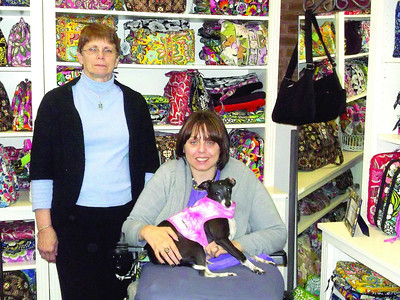 "Barbara and Denyse Miele, co-owners of Gustonian's Gifts, with Jewellz, an Italian greyhound. ""She's kind of a mascot of the shop,"" Denyse said"
