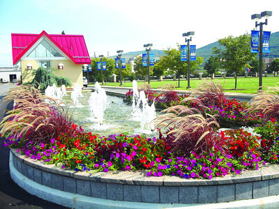 Visitors to Penn College of Technology are greeted with bubbling fountains and a burst of colorful flowers.