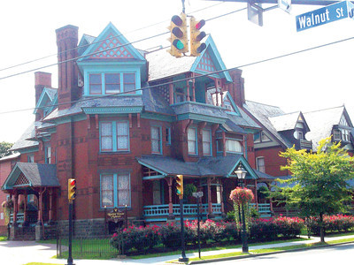 Built in 1888, the Rowley House Museum looks like a three-tiered cake with its Queen Anne-style carved wood gables and decorative chimneys. It is open to the public.