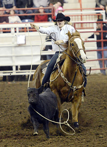 Sarah Shrawder, of Mifflinburg, competes in the break away roping competition of the Pennsylvania High School Rodeo at the PA Farm Show on Saturday night in Harrisburg.