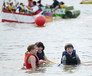 Hunter Beasley, 11, Jamie Lowthert, of Lewisburg, and Will Lowthert, 11 of Lewisburg, laugh in their sunken cardboard boat called the Twin V during the regatta at the Sunbury River Festival on Saturday afternoon.