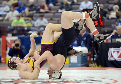 Milton's Ryan Solomon flips Chartiers-Houston's Garrett Vulcano during the championship bout of the 195lb weight class on Saturday afternoon in Hershey's Giant Center. It was Solomon's second consecutive state wrestling championship as well as his birthday.