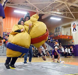 Garratt Barratt, a Central Columbia senior, jumps onto Brett Samoski, a Central Columbia Baseball Coach, during a Sumo Wrestling match to raise money for Challenger Baseball in Danville on Friday night.