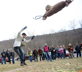 "Michael Espinosa, of Lewisburg, tosses an ""elk"" during the Danville German Society's 75th Annual Elk Toss, Charity Auction and Winter Festival on Saturday in Danville."