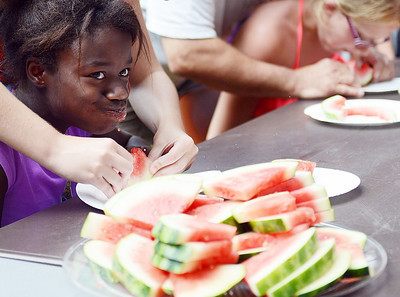 Miranda Metzger, 12 of New Columbia, tries to swallow during the Watermelon Eating Contest at the Old Fashioned Summer Celebration at R.B.Winter State Park on Saturday afternoon.