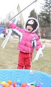 "Olivia King, 2 of Williamsport, catches a fish while ""ice fishing"" in Hufnagle Park in Lewisburg during the 10th Annual Heart of Lewisburg Ice Festival on Saturday."
