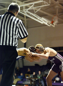 The referee watches as Shikellamy's Darryl Englehart and Shamokin's Chase Tillett wrestle on Thursday night.