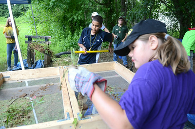 Kenny Fuentes, 12, left, Susquehanna Township, puts a shovel full of dirt into a sifter for Emma Grim, 10, Dillsburg, to look through for artifacts during a Archeology Camp at the Fort Halifax site in conjunction with the Ned Smith Center on Wednesday morning.
