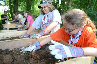 Chloe Bower, 11, left, Halifax, and Londyn Snyder, 9, Halifax, sort through dirt while looking for artifacts during Archeology Camp on Wednesday at Fort Halifax in conjunction with the Ned Smith Center.