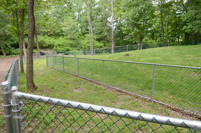 Fences divide the large dog and small dog area at the Shamokin Dam dog park.