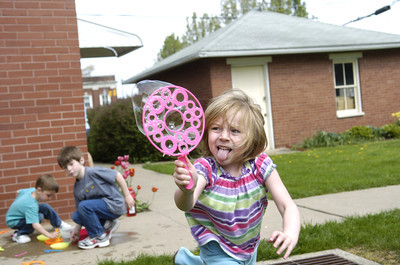 Madison Wagner, 4, runs with her bubble wand at the Mifflinburg Preschool on Tuesday.