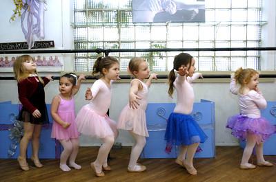 Josie Crabb, left, Zoe Naus, Ava Bulger, Gabby Rapp, Breeze Wilson, and Riley Laurence, warm up on the ballet bar at Karen Gronsky's Dance Studio in Danville.