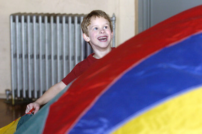 St. Cyril student Jackson Blansfield plays with a giant parachutte on Wednesday as he and fellow classmates help raise money for The Gateway Camp sponsored by the Columbia Montour Womens Center.