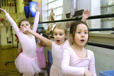 Breeze Wilson, left, Gabby Rapp, and Ava Bulger, give a flourish at the end of a song at the Karen Gronsky School of Dance in Danville.