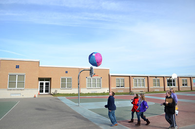 Liberty Valley fifth grade students Timothy White, left, Ruthanna Metzger, Hailey Hendricks, Kyler Gabel and Tara Bennage chase down a hot air balloon they made and launched during their lesson on Thursday morning.