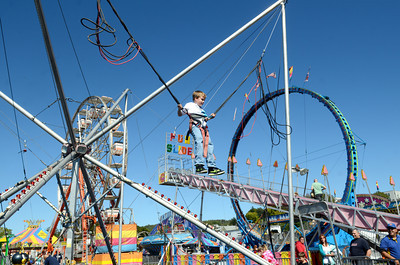 Matthew Barwick, 8, Shickshinny, jumps higher than the average human being, with a little help, at the Bloomsburg Fair on Tuesday afternoon.