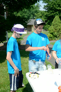 Cancer patient Chris Palumbo,14, left, Tioga NY, and Cobe Latsha, 15, Northumberland County, make elephant toothpaste together during an activity at Camp Dost at Camp Victory on Tuesday. Cobe's brother Ian, 13, is a cancer patient.