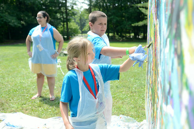 Lily Wetzel, 8, left, Montour County, and Jared Wilber, 8, Bradford County, paint together on a collaborative art project Tuesday during Camp Dost at Camp Victory.