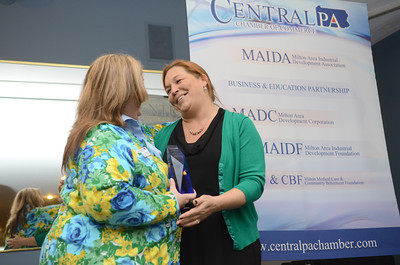 Maria Culp, left, President and CEO of the Central PA Chamber of Commerce, presents Kelly O'Brien-Gavin, director of the Greater Susquehanna KIZ, with the President's Award on Thursday at the chamber's annual meeting and award ceremony.