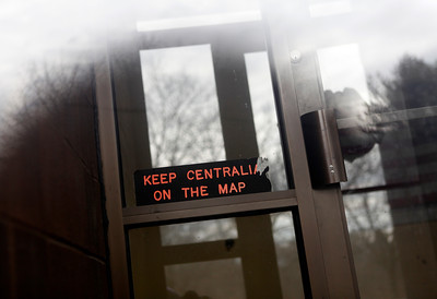 "FILE - In this Jan. 13, 2010 file photo, an old sign reading ""Keep Centralia On The Map"" is seen in the entrance of the closed Centralia Municipal Building in Centralia, Pa. Fifty years ago on Sunday, May 27, 2012, a fire at the town dump spread to a network of coal mines underneath hundreds of homes and business in the northeastern Pennsylvania borough of Centralia, eventually forcing the demolition of nearly every building. (AP Photo/Carolyn Kaster, File)"