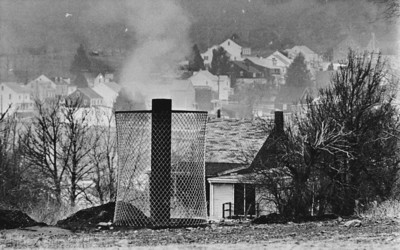 FILE - In this Jan. 26, 1983 file photo, smoke rises from the ground in Centralia, Pa., where and uncontrolled underground mine fire rages. Fifty years ago on Sunday, May 27, 2012, a fire at the town dump spread to a network of coal mines underneath hundreds of homes and business in the northeastern Pennsylvania borough of Centralia, eventually forcing the demolition of nearly every building. (AP Photo/Rusty Kennedy, File)