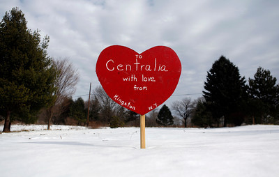 "FILE - In this Jan. 13, 2010, file photo, a painted, wooden heart with the words ""To Centralia with Love from Kingston N.Y."" stands in an open lot in Centralia, Pa. Fifty years ago on Sunday, May 27, 2012, a fire at the town dump spread to a network of coal mines underneath hundreds of homes and business in the northeastern Pennsylvania borough of Centralia, eventually forcing the demolition of nearly every building. (AP Photo/Carolyn Kaster, File)"