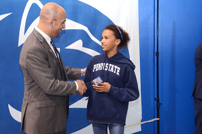 James Franklin, left, the new Penn State head football coach, shakes hands with Jannah Getz, 12, Pittston, at a stop on Tuesday at Penn College in Williamsport.