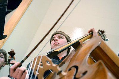Shamokin High School student Joey Deptula plays the bass during Thursday's District Band rehearsal on Thursday at the Milton High School.