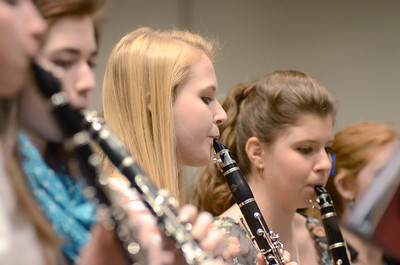 Lewisburg High School student Kate Landis plays her Clarinet during a District Band concert rehearsal on Thursday at the Milton High School