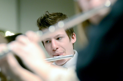 Benjamin Nesselrodt of Hughesville plays his flute during Thursday's District Band rehearsal at the Milton High School.