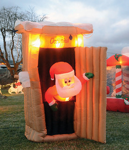 One of Doreen's favorite pieces, Santa in an outhouse.