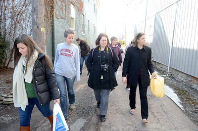 Junk Walk participants Morgan Slade, left, Anna Kell, Tracy Billet, and Pam Campanaro, keep their eyes peeled looking for discarded treasure for their art projects in connection with Bucknell's downtown art gallery.